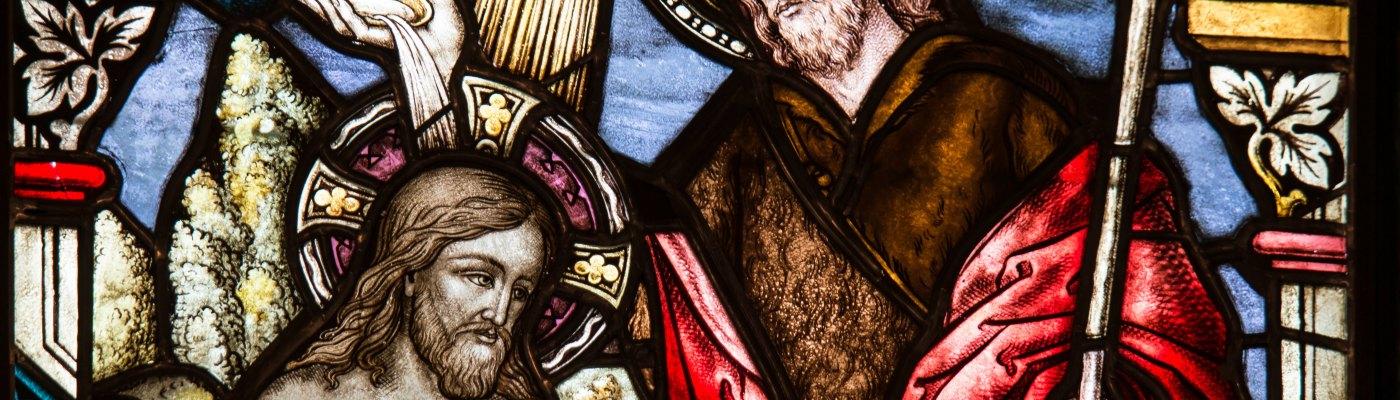 Stained glass window depicting the prophet John baptizing Jesus