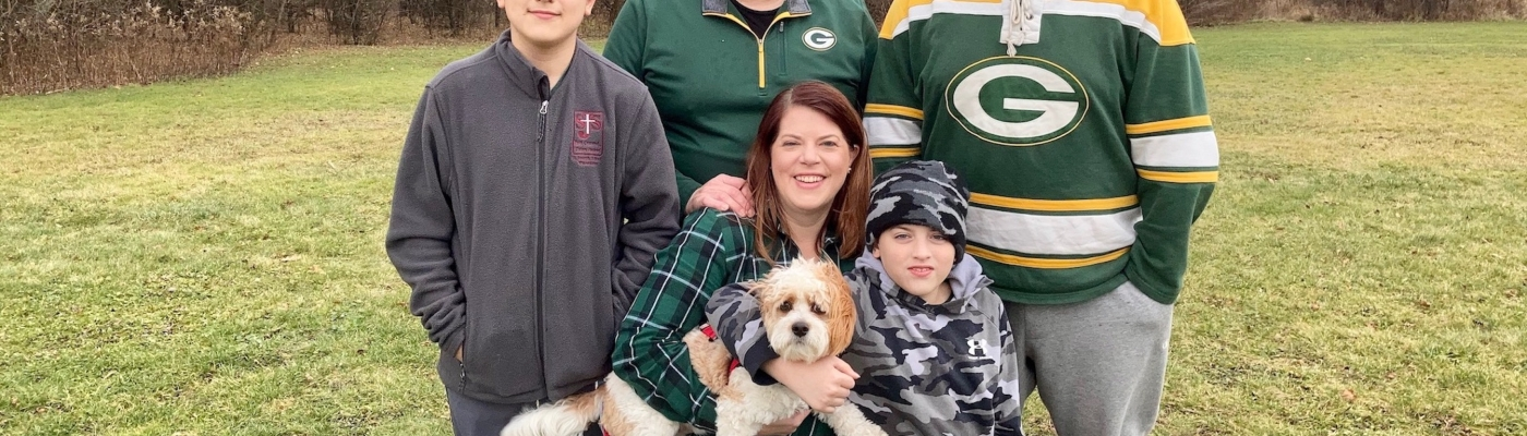 Patty Ingrilli with her husband, three sons, and their dog