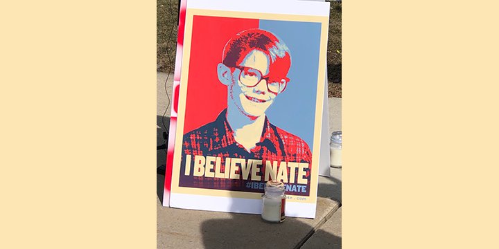 """Sign that says """"I Believe Nate"""" at the rally"""