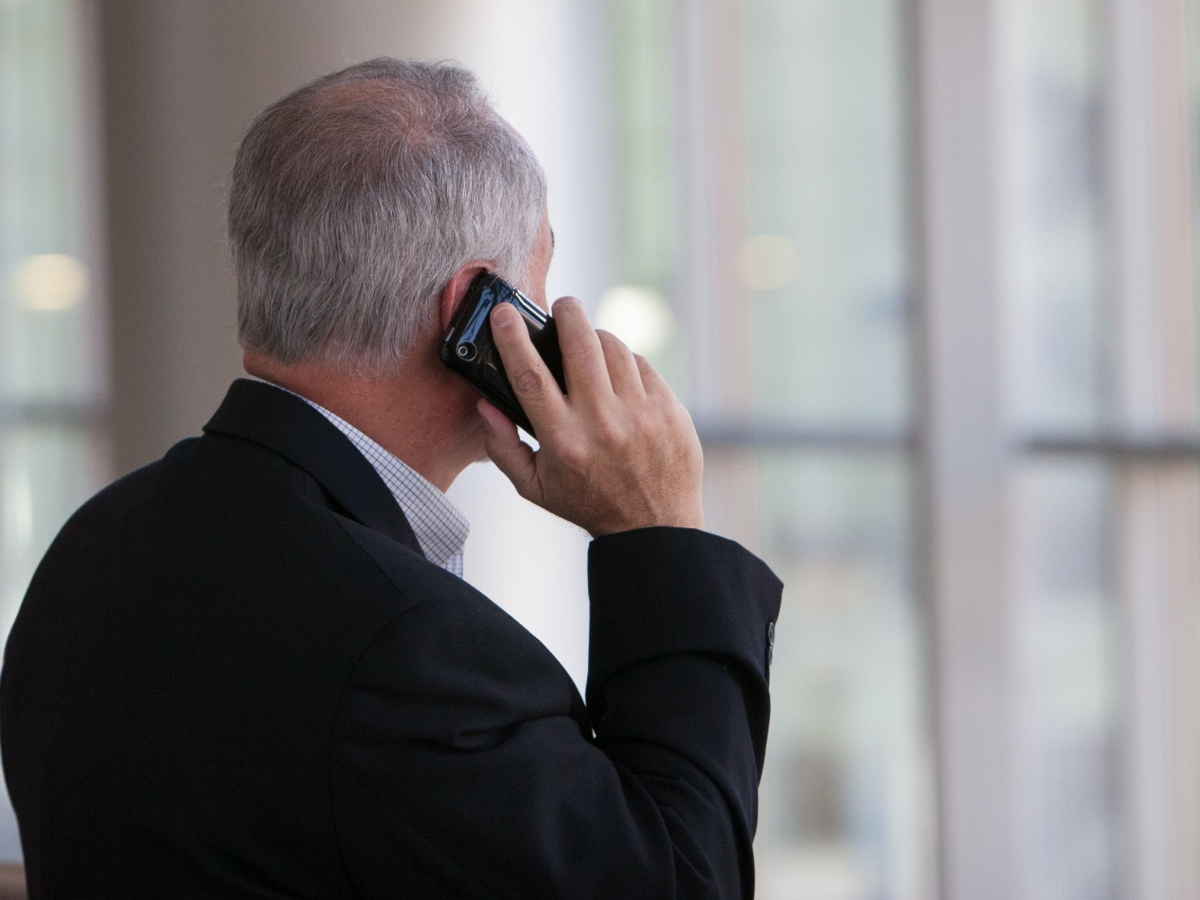 Man talking on the phone with his back to the camera